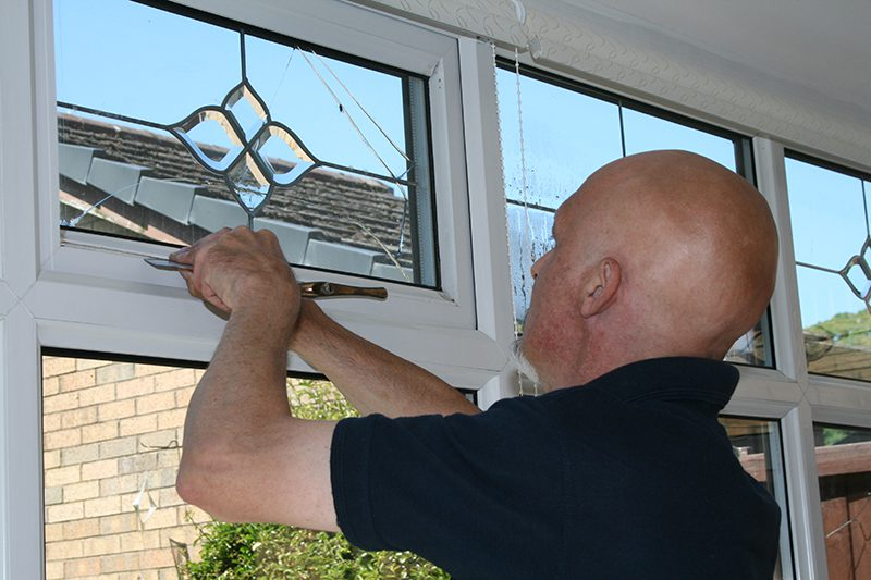 Cloudy2Clear installer repairing a window.